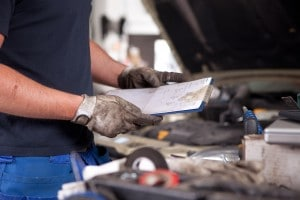 bigstock-Detail-of-a-mechanic-holding-a-29356376